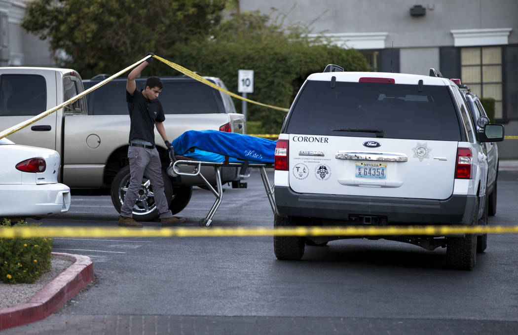A body is removed as investigators work the scene of a shooting at a wellness and pain care facility at 311 North Buffalo Drive in Las Vegas on Thursday, June 29, 2017. Richard Brian Las Vegas Rev ...