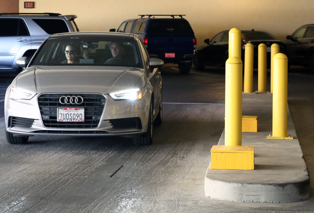 Hotel gusts drive through metal and concrete barriers as they exit the Wynn hotel-casino parking garage in Las Vegas on Friday, June 30, 2017. Automated parking gates will be in place and customer ...