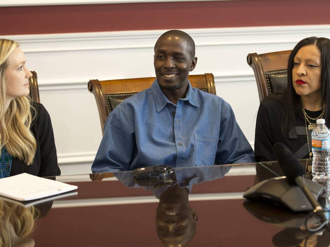DeMarlo Berry, center, with his attorney Samantha Wilcox, left, and his wife Odilia Berry during a news conference at the law office of Eglet Prince in downtown Las Vegas on Friday, June 30, 2017, ...