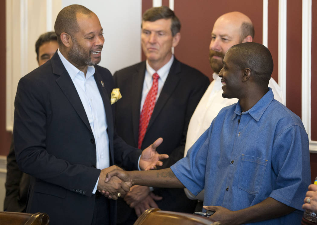 Nevada Sen. Aaron D. Ford, D-Las Vegas, left, greets DeMarlo Berry at a news conference at the law office of Eglet Prince in downtown Las Vegas on Friday, June 30, 2017, after Berry was exonerated ...