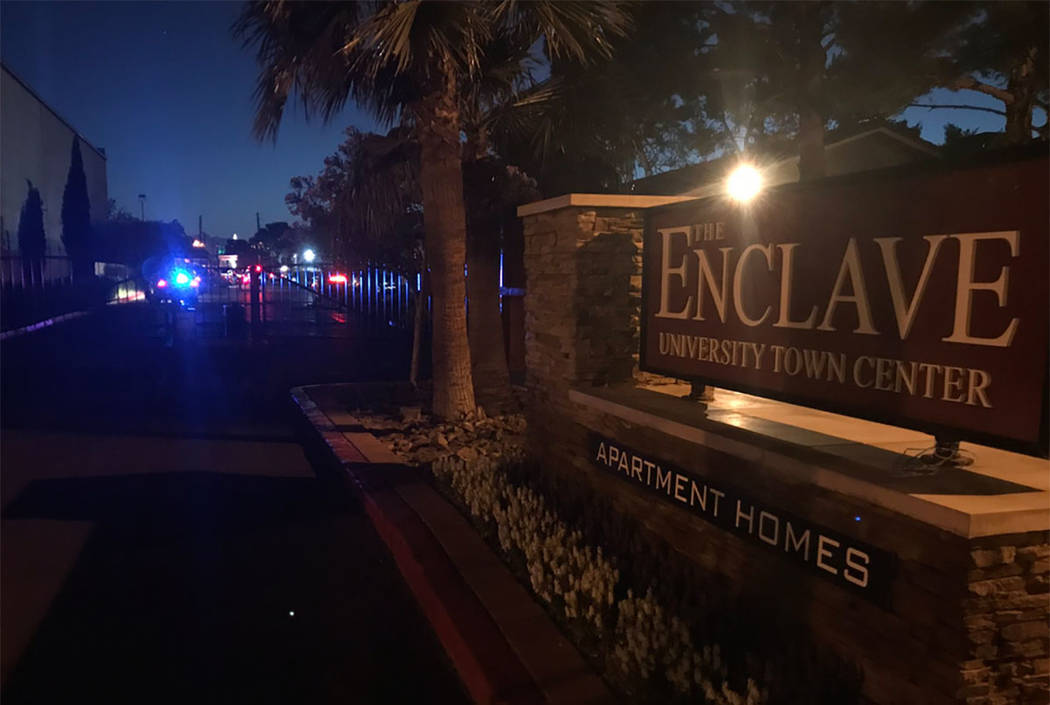 Police work the scene of a shooting at The Enclave apartments at 4801 Spencer St., just north of Tropicana Avenue, in Las Vegas. (Rachel Crosby/Las Vegas Review-Journal)