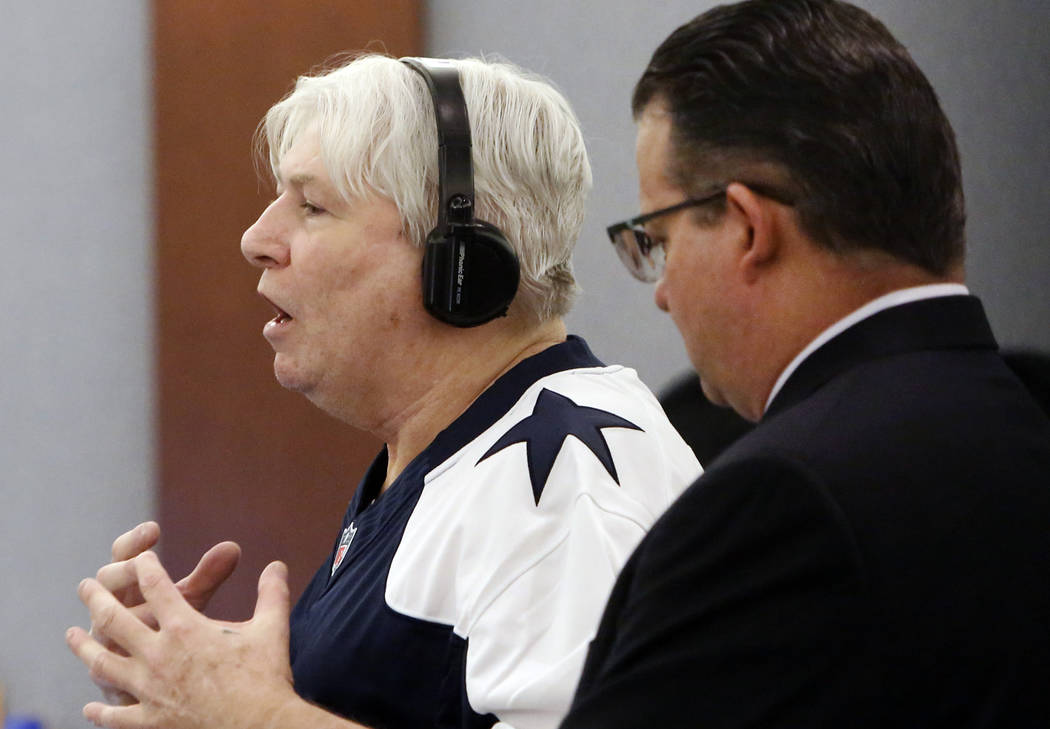 Thomas Randolph, left, wearing a Tony Romo jersey, delivers his statement to the jury during his death penalty phase trial as his attorney Clark Patrick looks on at the Regional Justice Center in  ...