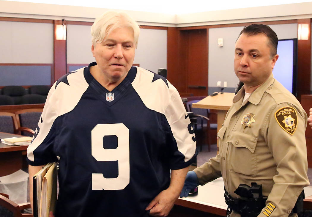 Thomas Randolph, wearing a Tony Romo jersey, leaves the courtroom after appearing in his death penalty phase trial at the Regional Justice Center in Las Vegas on Friday, June 30, 2017. (Bizuayehu  ...