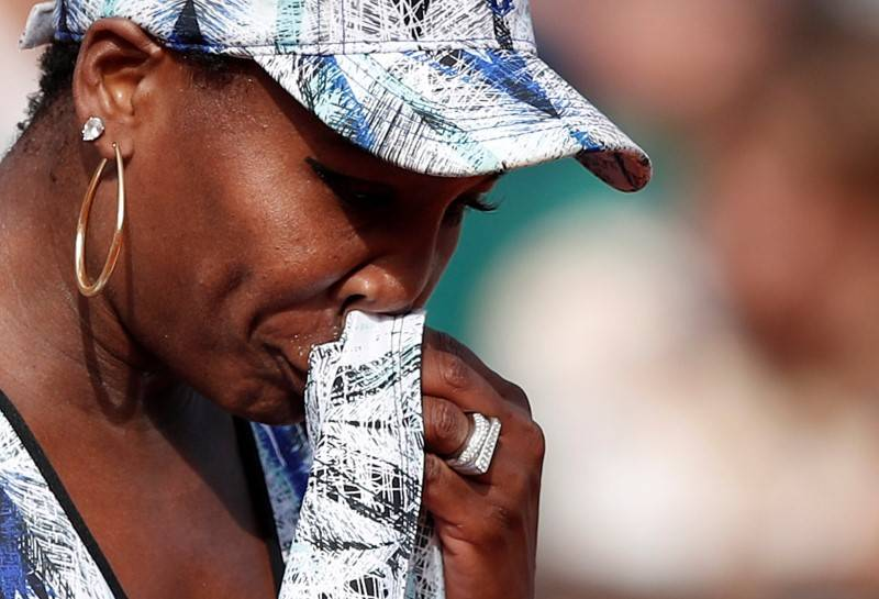 Venus Williams looks dejected after losing her fourth round match against Switzerland's Timea Bacsinszky. (Reuters/Benoit Tessier)