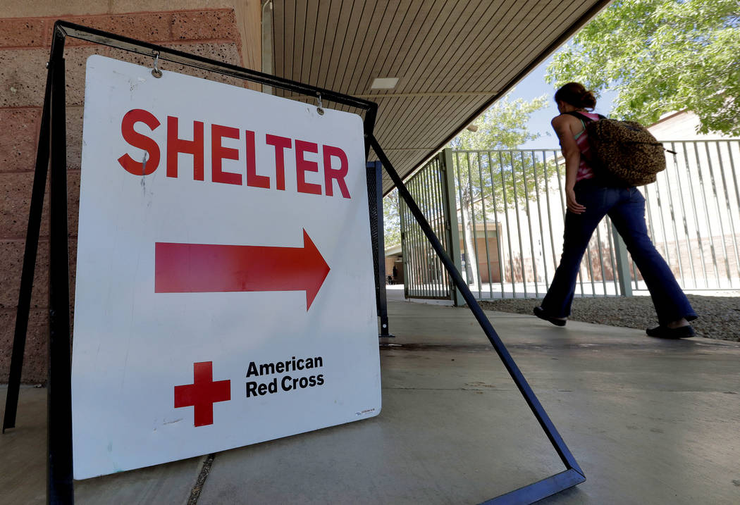 An evacuee from the Goodwin fire enters a Red Cross shelter, Wednesday, June 28, 2017, in Prescott Valley, Ariz. Forest officials say over a dozen campground and other recreation areas have been c ...