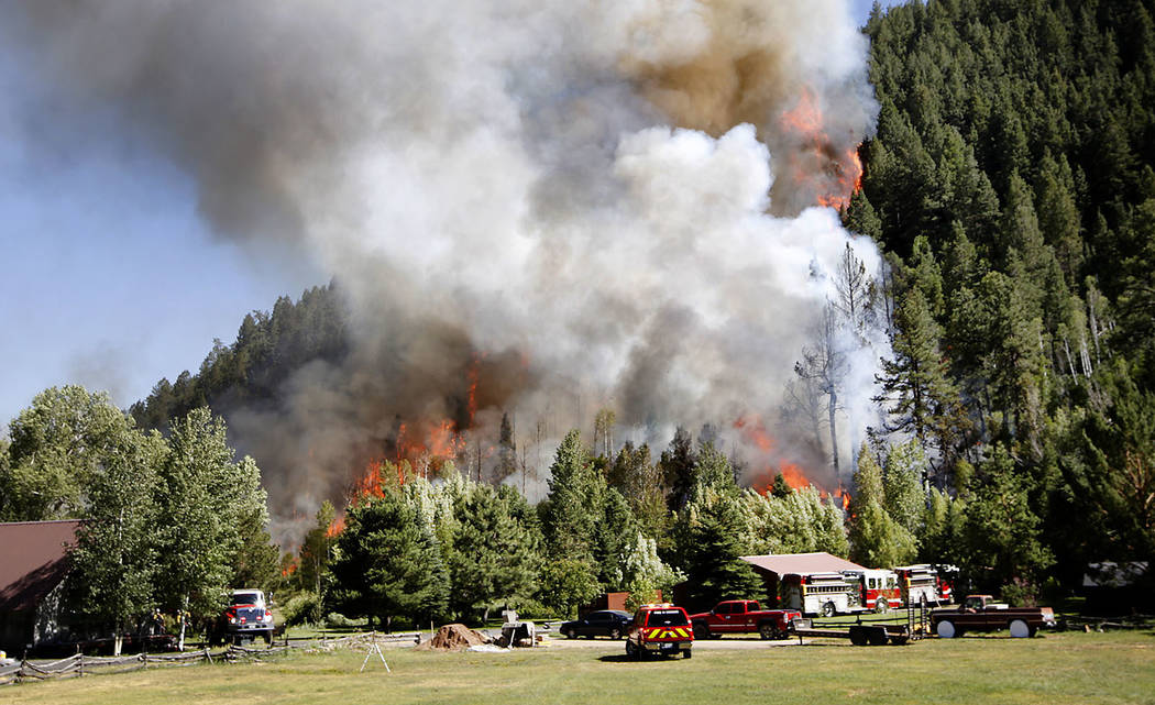 A structure burning on Lightner Creek Road west of Durango, Colo., on Wednesday, June 28, 2017, quickly spread into the surrounding forest, creating the Lightner Creek Fire and burning an estimate ...