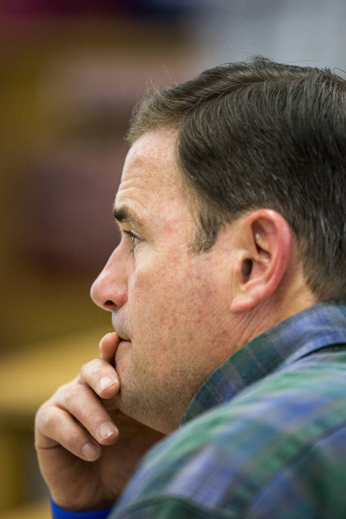 Arizona Gov. Doug Ducey listens to a briefing on a northern Arizona wildfire at a command center set up at Bradshaw Mountain Middle School on Thursday, June 29, 2017, in Dewey, Ariz. Crews made co ...