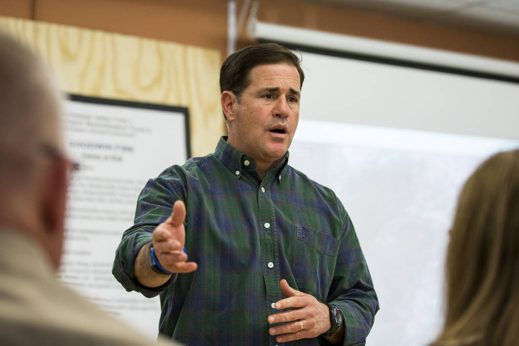 Gov. Doug Ducey speaks to local government officials about the northern Arizona wildfire at Bradshaw Mountain Middle School on Thursday, June 29, 2017, in Dewey, Ariz. Crews made considerable prog ...