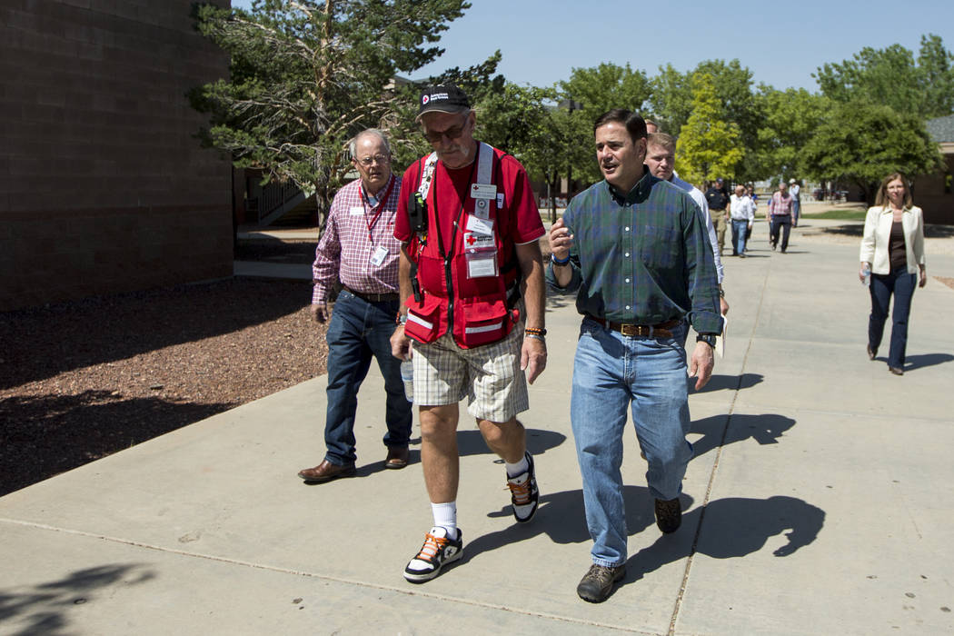Arizona Gov. Doug Ducey tours the fire's evacuation center in Prescott Valley, Ariz., Thursday, June 29, 2017. Crews made considerable progress Thursday fighting an Arizona forest fire that shut d ...
