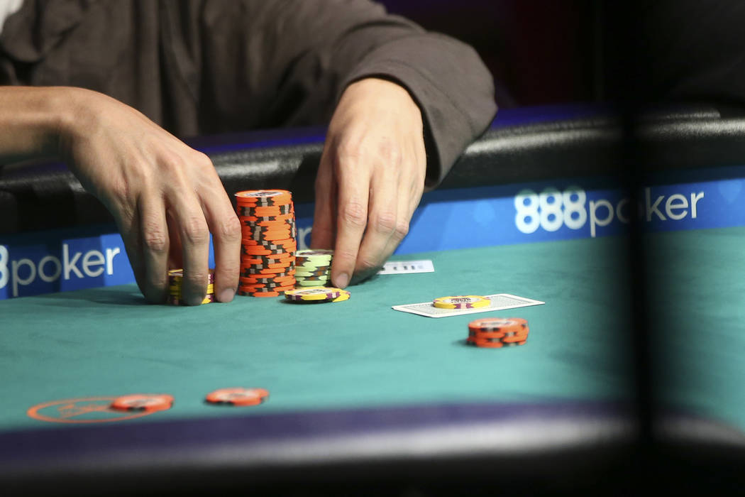 Carson City resident Ian Steinman stacks his chips while competing in the $1,500 No-Limit Hold'em event during the World Series of Poker at the Rio hotel-casino in Las Vegas on Thursday, June 29,  ...