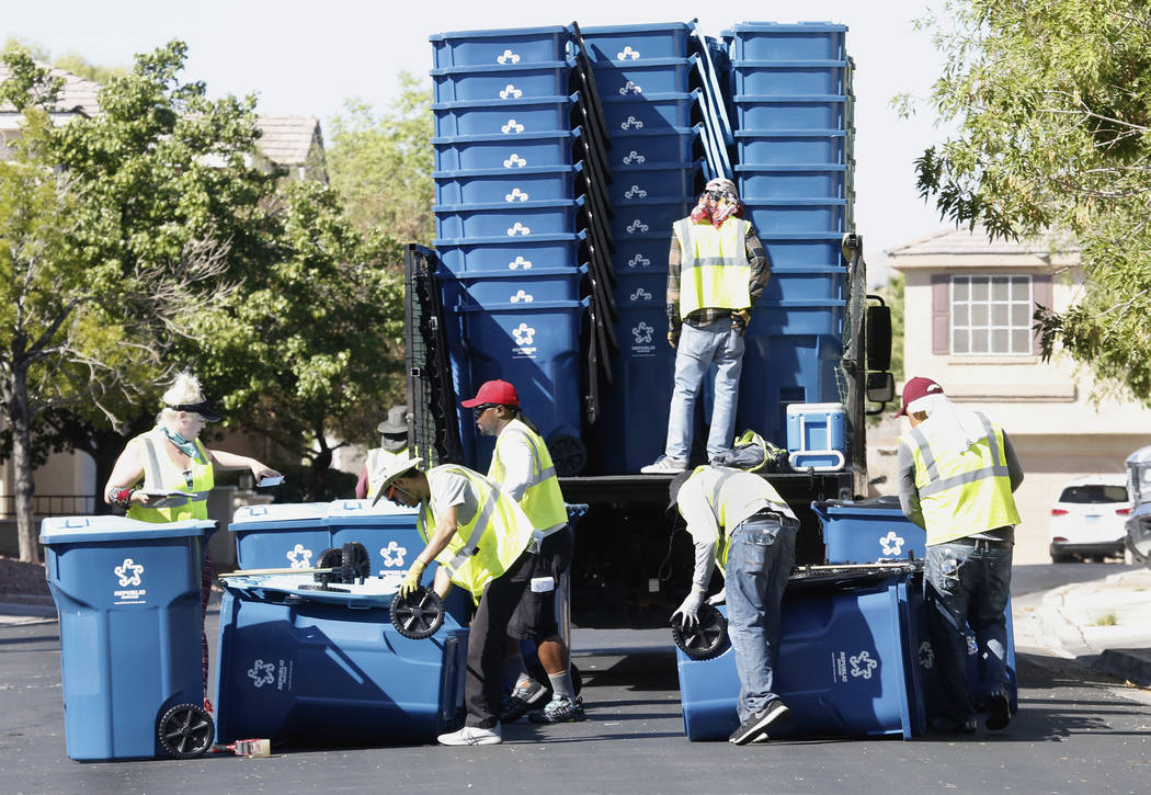 Republic Services of Southern Nevada employees deliver new recycling and trash bins to Summerlin residents on Friday, June 30, 2017. Bizuayehu Tesfaye/Las Vegas Review-Journal @bizutesfaye