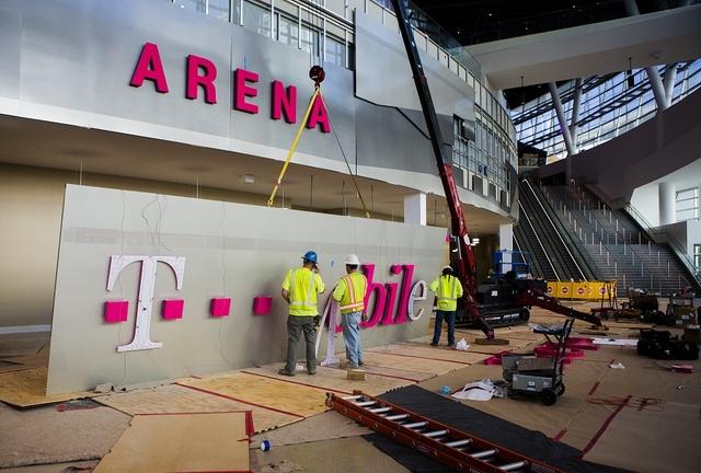 Men work on a sign inside T-Mobile Arena on Thursday, March 24, 2016. Jeff Scheid/Las Vegas Review-Journal Follow @jlscheid