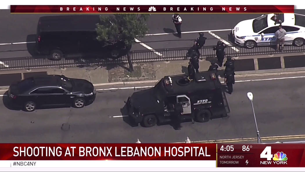 In this image taken from video provided by WNBC 4 New York, emergency personnel converge on Bronx Lebanon Hospital in New York, after a gunman opened fire there on Friday, June 30, 2017. (NBC 4 Ne ...
