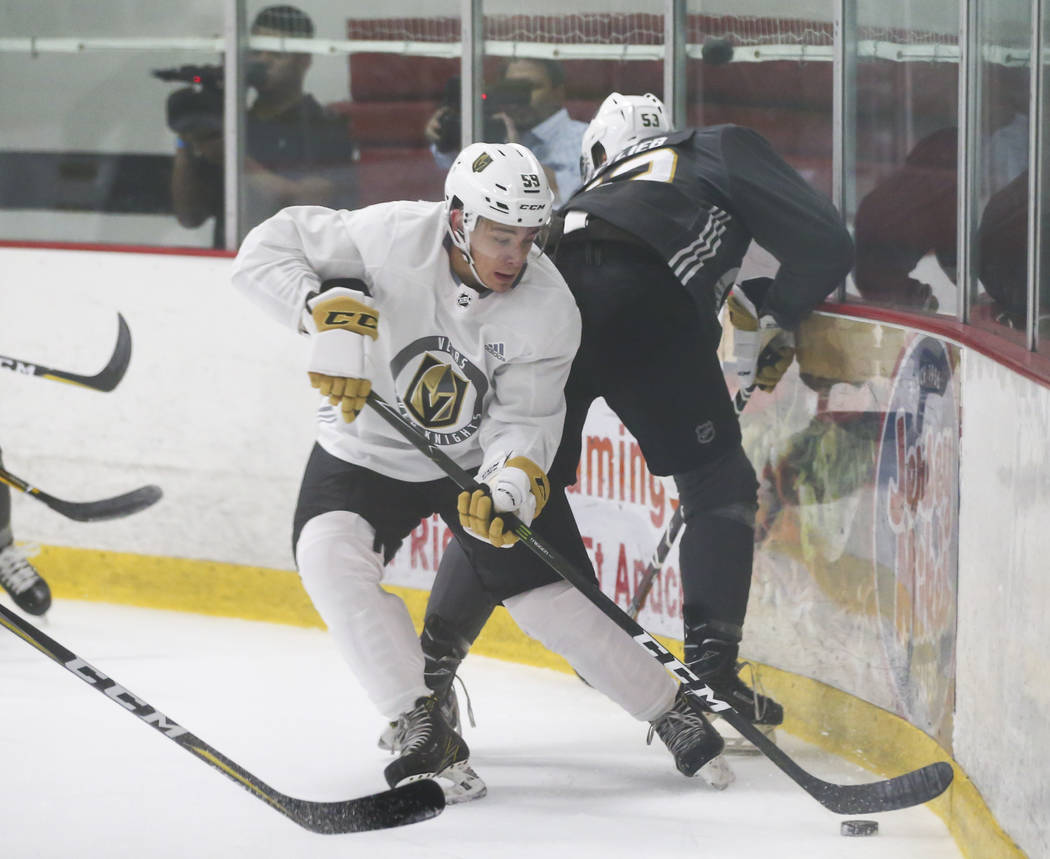 Vegas Golden Knights' Alex Barre-Boulet, left, drives the puck past Max Gottlieb during a scrimmage as part of the team's development camp at Las Vegas Ice Center in Las Vegas on Friday, June 30,  ...