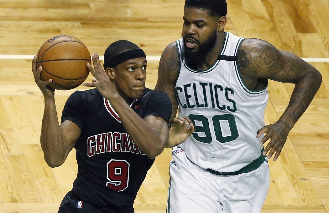 Chicago Bulls' Rajon Rondo (9) drives past Boston Celtics' Amir Johnson (90) during the second quarter of a first-round NBA playoff basketball game Sunday, April 16, 2017, in Boston. (AP Photo/Mic ...