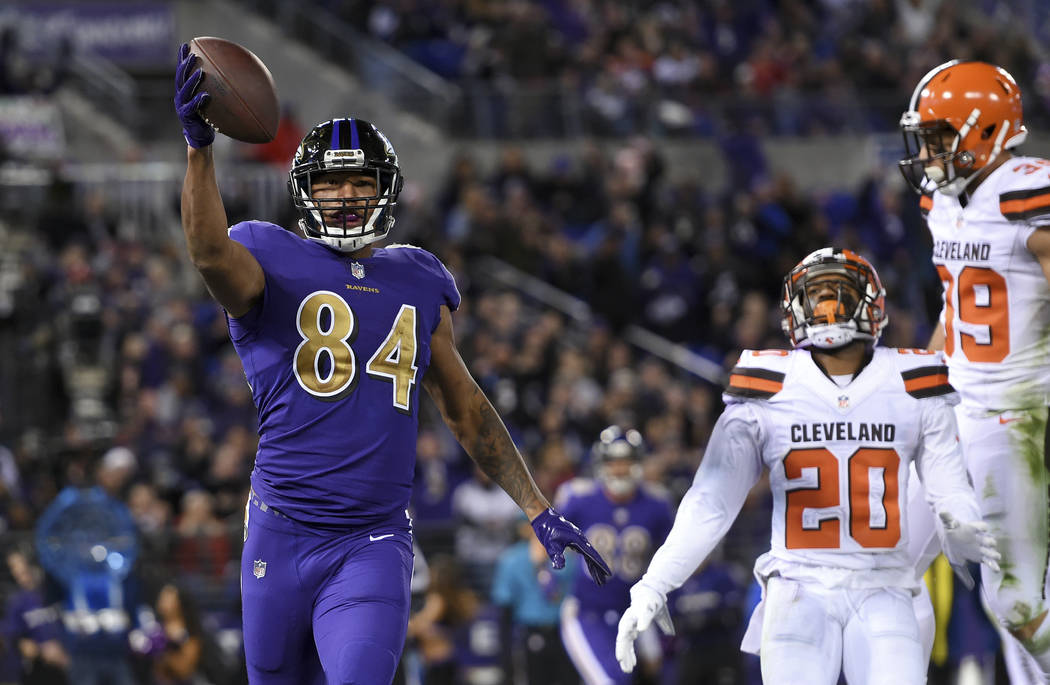 Baltimore Ravens tight end Darren Waller (84) celebrates after scoring a touchdown in front of Cleveland Browns cornerback Briean Boddy-Calhoun (20) and defensive back Ed Reynolds II in the second ...