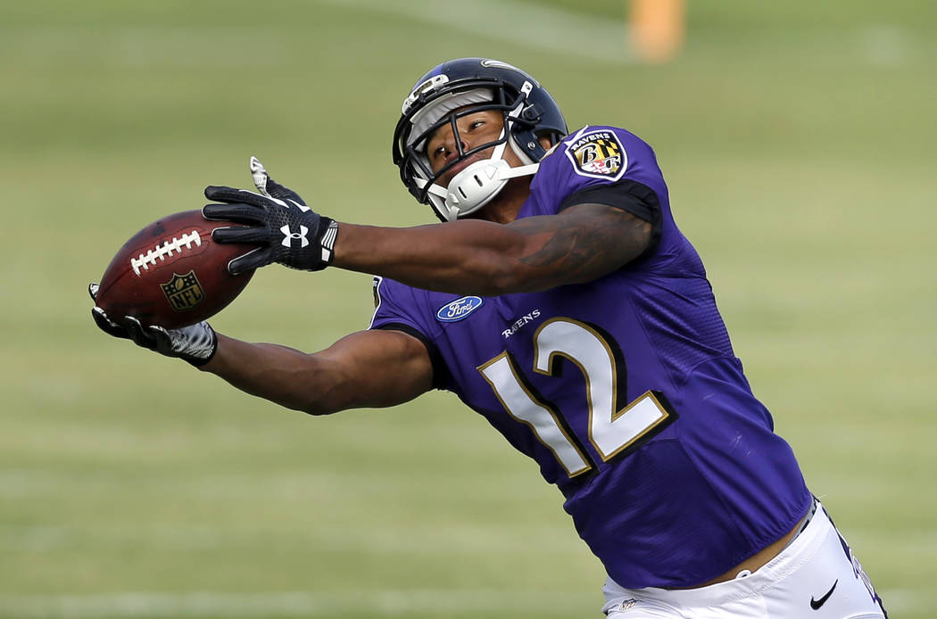 Baltimore Ravens wide receiver Darren Waller makes a catch during NFL football training camp, Thursday, Aug. 6, 2015, in Owings Mills, Md. (AP Photo/Patrick Semansky)