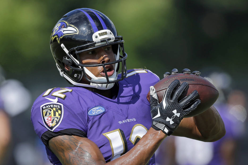 Baltimore Ravens wide receiver Darren Waller makes a catch during NFL football training camp, Saturday, Aug. 8, 2015, in Owings Mills, Md. (AP Photo/Patrick Semansky)