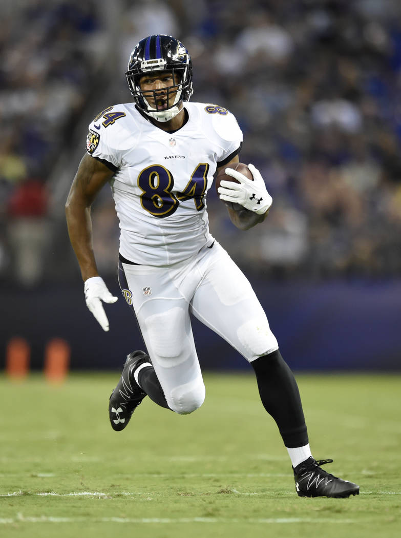 Baltimore Ravens wide receiver Darren Waller rushes the ball in the first half of a preseason NFL football game against the Detroit Lions, Saturday, Aug. 27, 2016, in Baltimore. (AP Photo/Gail Burton)