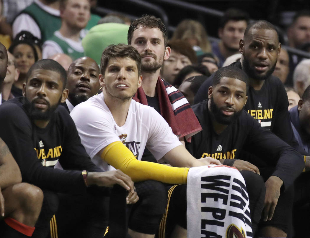 Cleveland Cavaliers, from left to right, Kyrie Irving, Kyle Korver, Kevin Love, Tristan Thompson and LeBron James watch from the bench during the second half of Game 2 of the NBA basketball Easter ...