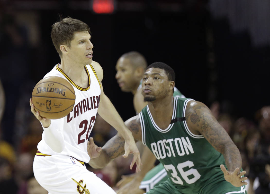 Cleveland Cavaliers' Kyle Korver (26) passes around Boston Celtics' Marcus Smart (36) during the first half of Game 3 of the NBA basketball Eastern Conference finals, Sunday, May 21, 2017, in Clev ...