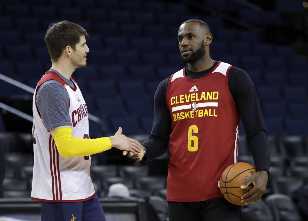 Cleveland Cavaliers' LeBron James, right, shakes hands with teammate Kyle Korver during an NBA basketball practice, Wednesday, May 31, 2017, in Oakland, Calif. The Cavaliers face the Golden State  ...