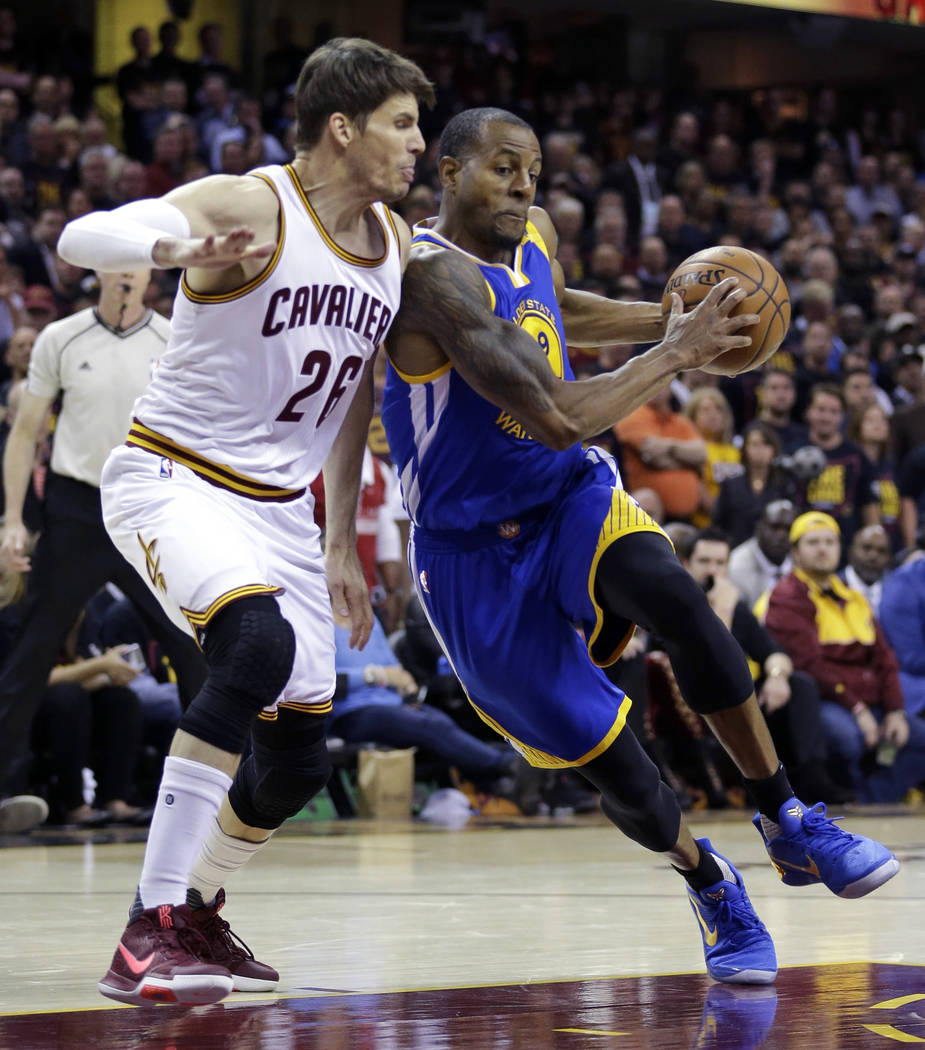 Golden State Warriors forward Andre Iguodala, right, drives on Cleveland Cavaliers guard Kyle Korver (26) during the first half of Game 3 of basketball's NBA Finals in Cleveland, Wednesday, June 7 ...
