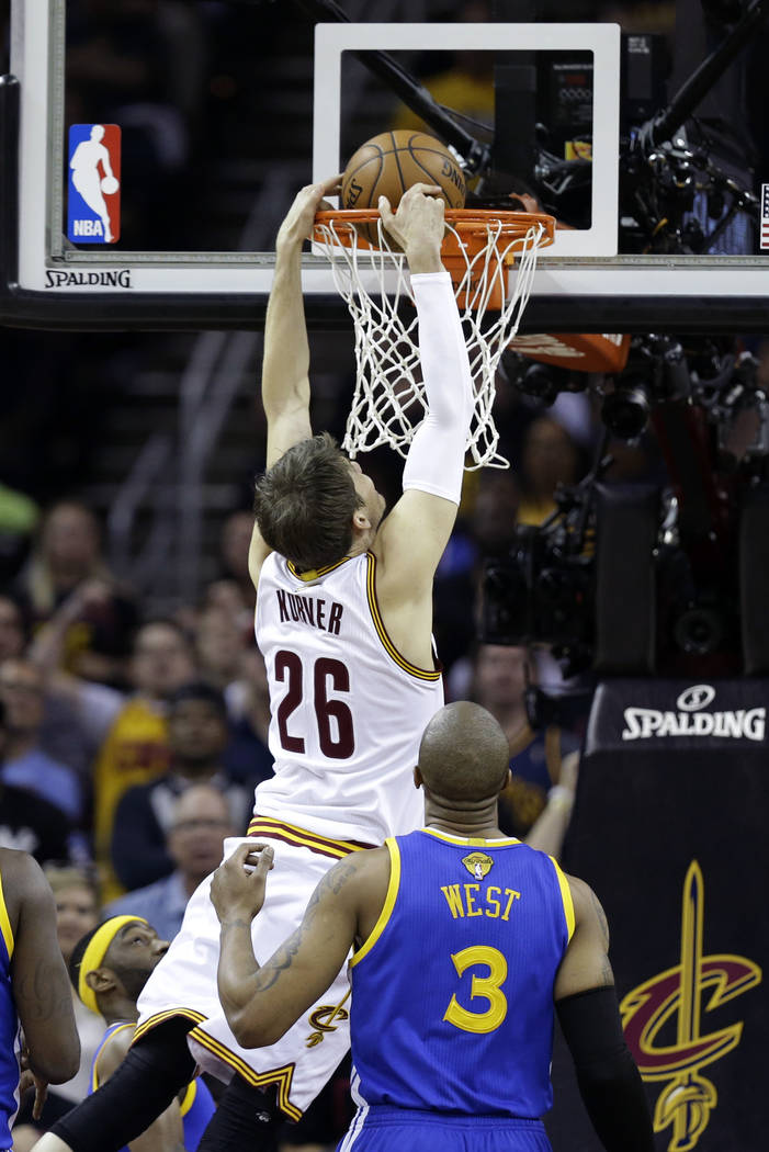 Cleveland Cavaliers guard Kyle Korver (26) dunks against the Golden State Warriors during the first half of Game 3 of basketball's NBA Finals in Cleveland, Wednesday, June 7, 2017. (AP Photo/Tony  ...