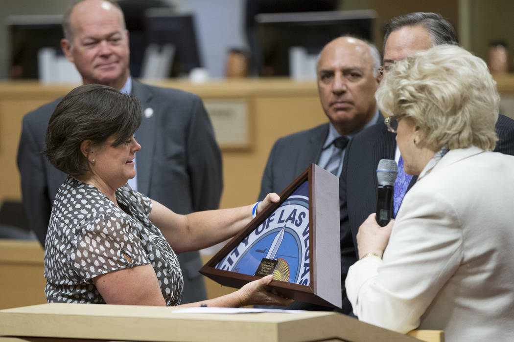 Las Vegas City Manager Betsy Fretwell, left, receives a gift during her departure ceremony at Las Vegas City Hall on Wednesday, June 21, 2017. (Erik Verduzco/Las Vegas Review-Journal)