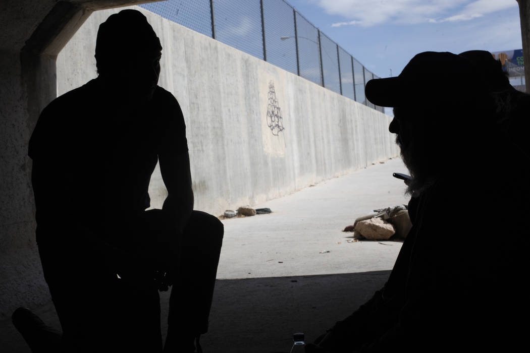 Matthew O'Brien speaks to Cory  near an entrance to the flood tunnels on Tuesday, May 16, 2017, in Las Vegas. O'Brien spent years interviewing the hundreds of people that live there, eventually wr ...