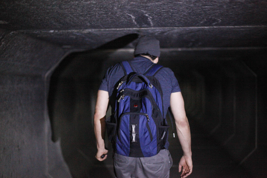 """Matthew O'Brien walks through a flood tunnel on Tuesday, May 16, 2017, in Las Vegas. O'Brien spent years interviewing the hundreds of people that live there, eventually writing the book """" ..."""