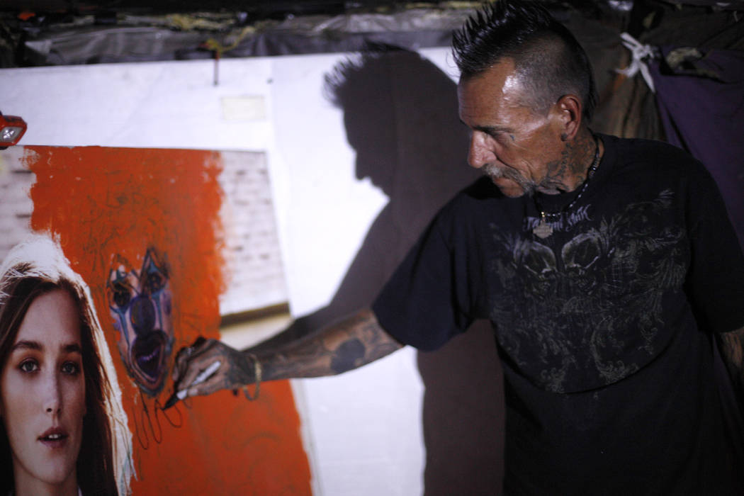 """""""Spike"""" draws a clown on a poster at his encampment inside a flood tunnel on Tuesday, May 16, 2017, in Las Vegas. Rachel Aston Las Vegas Review-Journal @rookie__rae"""