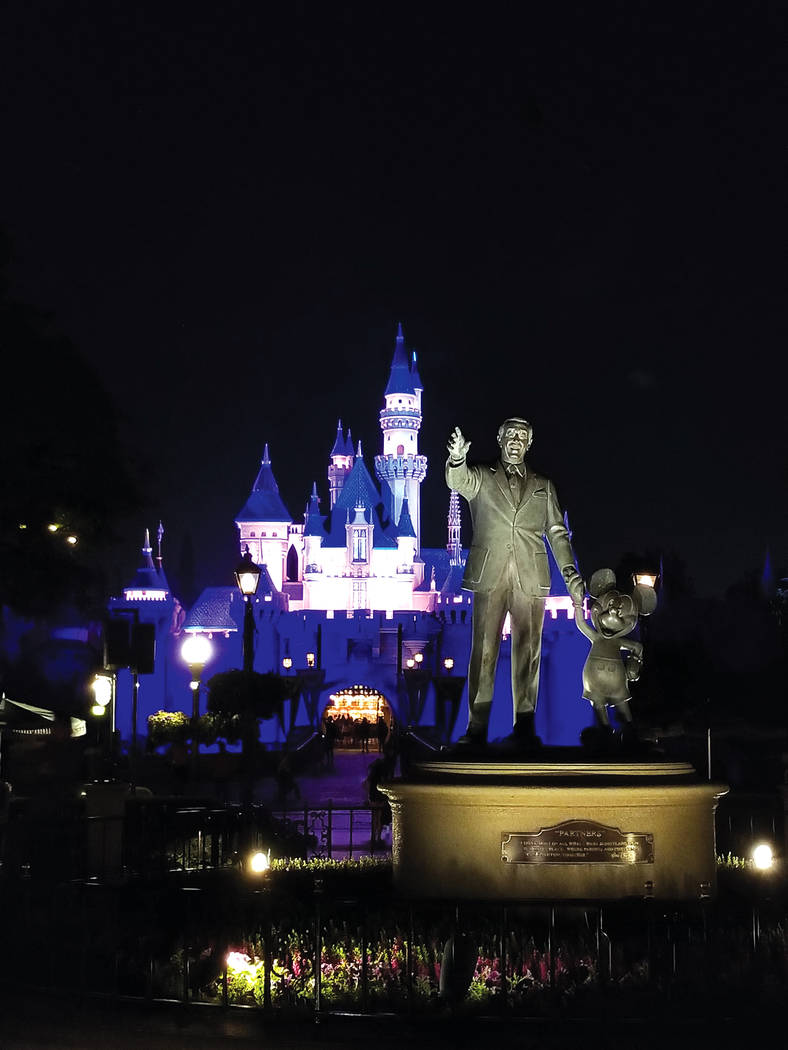 A statue of Walt Disney and Mickey Mouse in front of Sleeping Beauty's Castle at Disneyland in Anaheim, California, on Monday, June 19​​, 2017. Rochelle Richards Las Vegas Review-Journal