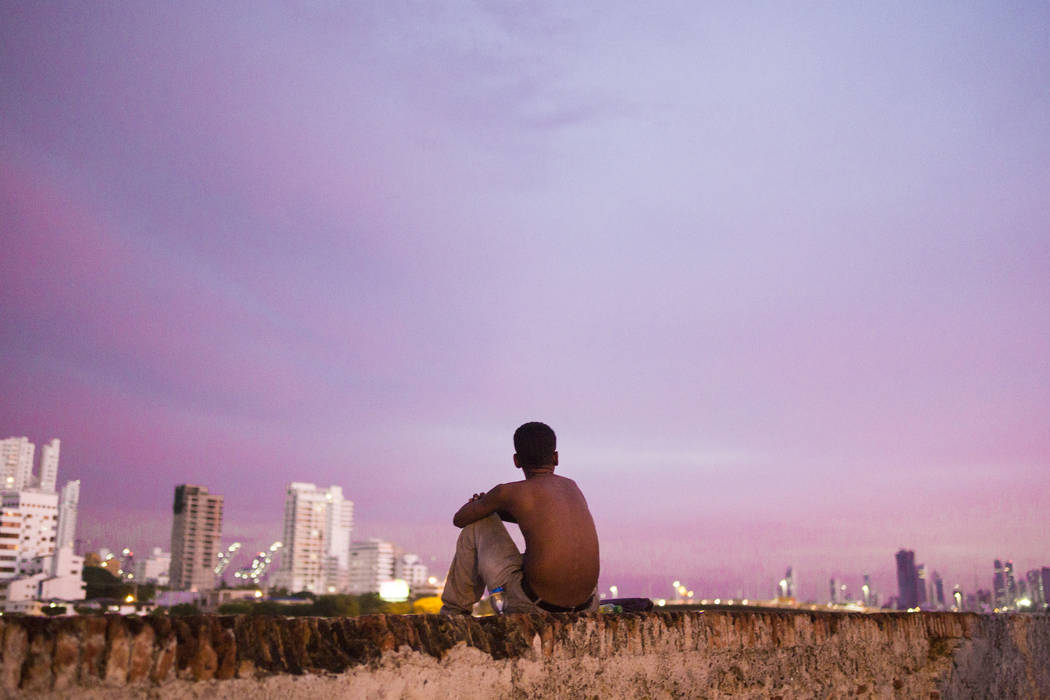 A boy watches the sun set over Cartagena, Colombia (Elizabeth Brumley/Las Vegas Review-Journal)