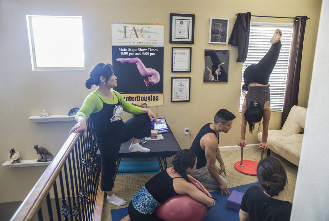 Otgo Waller, left, leads a training session at her home studio on Tuesday, June 13, 2017, in Las Vegas. Waller is a contortionist from Mongolia with over 35 years of industry experience. Benjamin  ...
