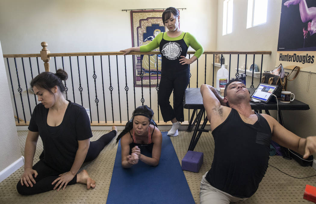 Victoria Niederhoffer, Kristi Toguchi, Otgo Waller and Jonathan Manzanares work out during a training session at Waller's home studio on Tuesday, June 13, 2017, in Las Vegas. Waller is a contortio ...