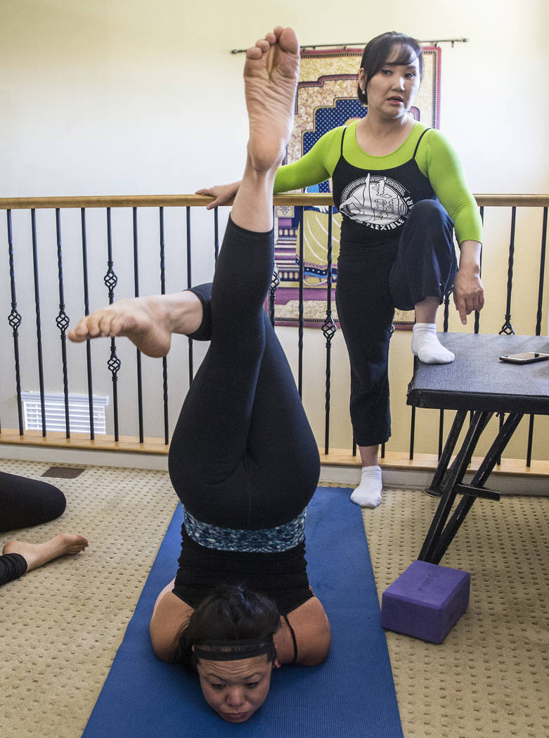 Otgo Waller, right, helps Kristi Toguchi stretch during a training session at Waller's home studio on Tuesday, June 13, 2017, in Las Vegas. Waller is a contortionist from Mongolia with over 35 yea ...