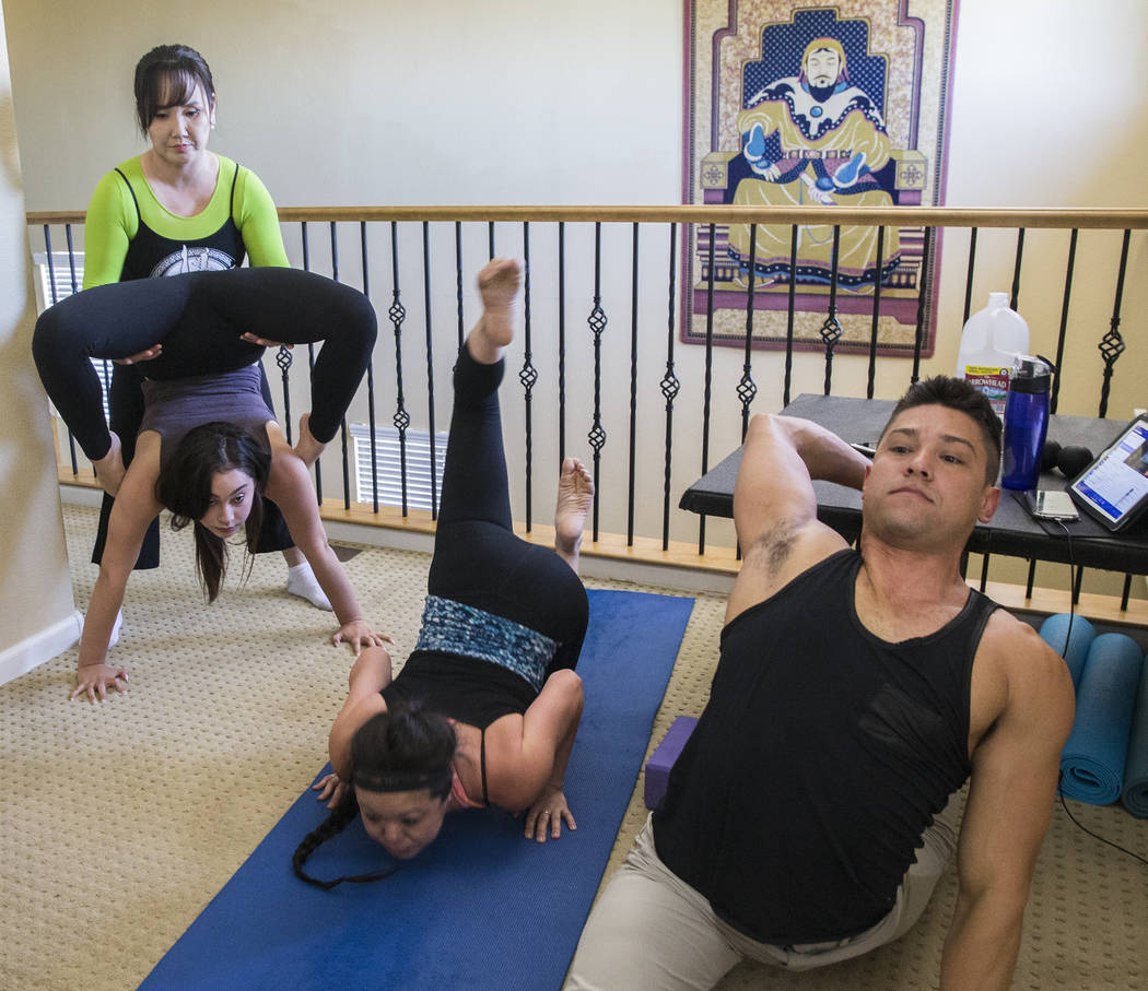 Otgo Waller, top/left, helps Ariana Sokol stretch during a training session at her home studio on Tuesday, June 13, 2017, in Las Vegas. Waller is a contortionist from Mongolia with over 35 years o ...