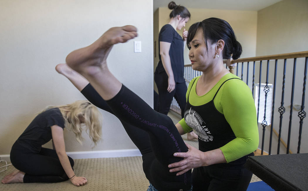 Otgo Waller, right, leads a training session at her home studio on Tuesday, June 13, 2017, in Las Vegas. Waller is a contortionist from Mongolia with over 35 years of industry experience. Benjamin ...