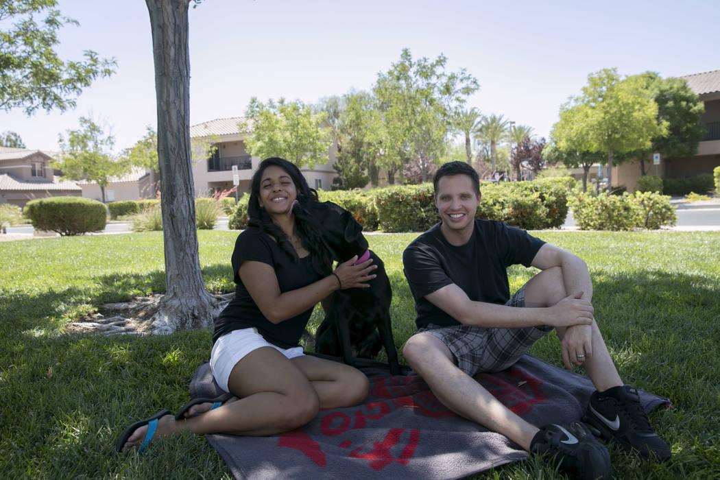 Sunethra Muralidhara, left; her husband, Michael Mohan; and their dog, Deming, in North Las Vegas, Saturday, July 1, 2017. (Gabriella Angotti-Jones/Las Vegas Review-Journal) @gabriellaangojo