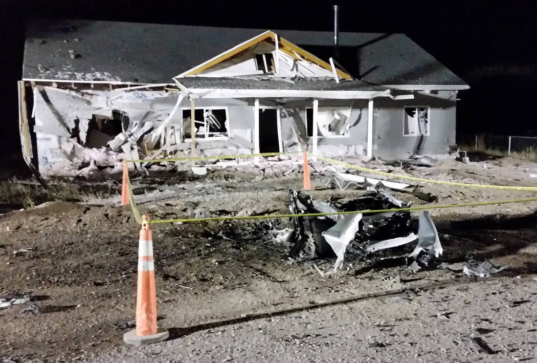 Police tape surrounds what's left of a rented vehicle that was blown up in a July 13, 2016, bomb attack in Panaca, 165 miles northeast of Las Vegas. Mike Bivins, who lives across the street from w ...