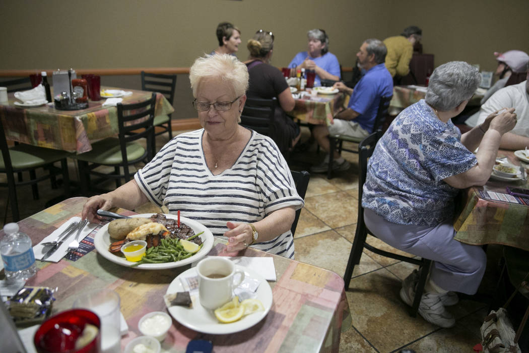 Mabel Mead prepares to dig into her lobster and steak dinner at the Club Fortune Casino in Henderson, Wednesday, June 14, 2017. Gabriella Angotti-Jones Las Vegas Review-Journal @gabriellaangojo