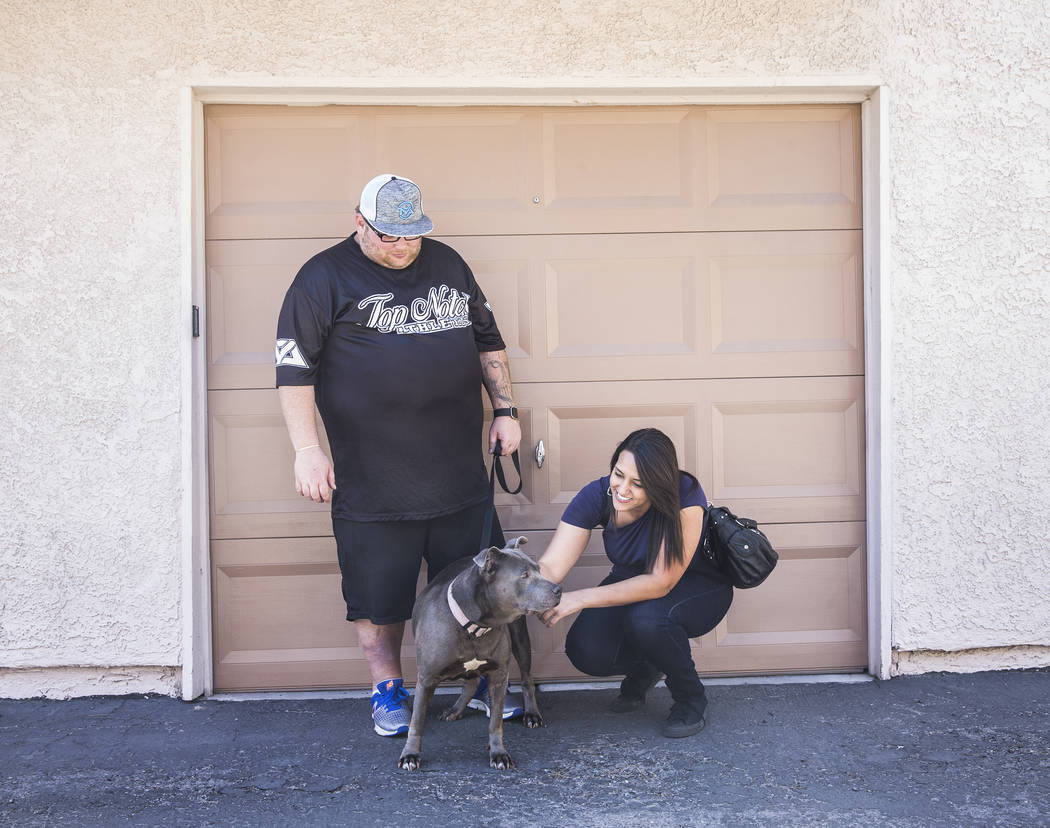 WAG dog walker Amy Abdelsayed, right, meets WAG customer Joseph Thomas and his blue pit bull Princess on Tuesday, June 13, 2017, at Thomas' home, in Las Vegas. (Benjamin Hager/Las Vegas Review-Jou ...