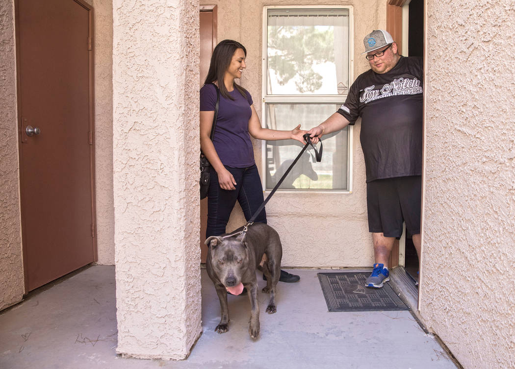 WAG dog walker Amy Abdelsayed, left, meets WAG customer Joseph Thomas and his blue pit bull Princess on Tuesday, June 13, 2017, at Thomas' home, in Las Vegas. (Benjamin Hager/Las Vegas Review-Jour ...