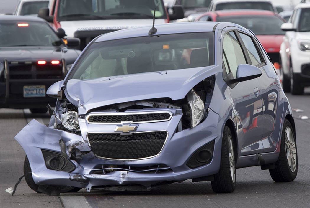 The scene of a crash on northbound U.S. Highway 95 near East Tropicana Avenue on Thursday, June 8, 2017. (Richard Brian Las Vegas Review-Journal @vegasphotograph)