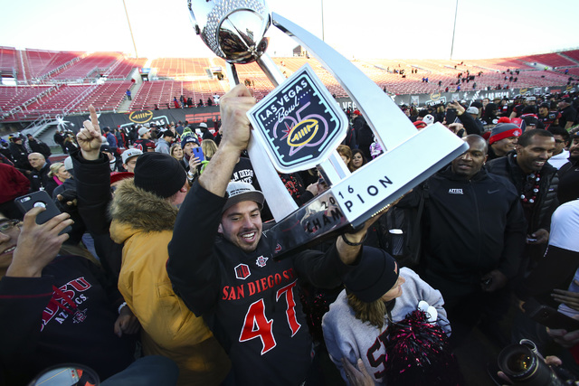 San Diego State wide receiver Marc Ellis (47) celebrates after defeating Houston in the Las Vegas Bowl at Sam Boyd Stadium in Las Vegas on Saturday, Dec. 17, 2016. San Diego State won 34-10. (Chas ...