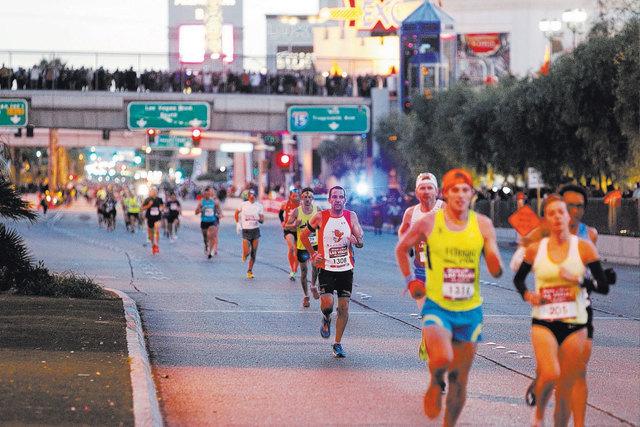 Runners compete during the Rock 'n' Roll Las Vegas marathon on the Strip near Monte Carlo casino-hotel in Las Vegas Sunday, Nov. 16, 2014. (Erik Verduzco/Las Vegas Review-Journal)
