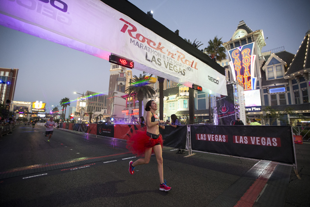 Martha Williams completes the 10K run in the annual Rock 'n' Roll Marathon at the Strip near The Mirage hotel-casino on Sunday, Nov. 13, 2016, in Las Vegas. Erik Verduzco/Las Vegas R ...