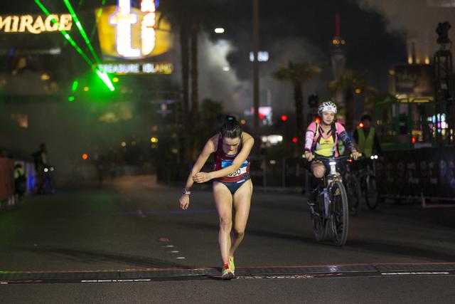 Katja Goldring completes the half-marathon run in the annual Rock 'n' Roll Marathon at the Strip near The Mirage hotel-casino on Sunday, Nov. 13, 2016, in Las Vegas. Erik Verduzco/La ...
