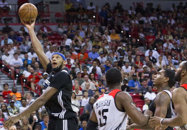Minnesota Timberwolves forward Adreian Payne (33) shoots a hook shot over Chicago Bulls forward Raymar Morgan (15) during the NBA Summer League championship game at Cox Pavilion at UNLV on Monday, ...
